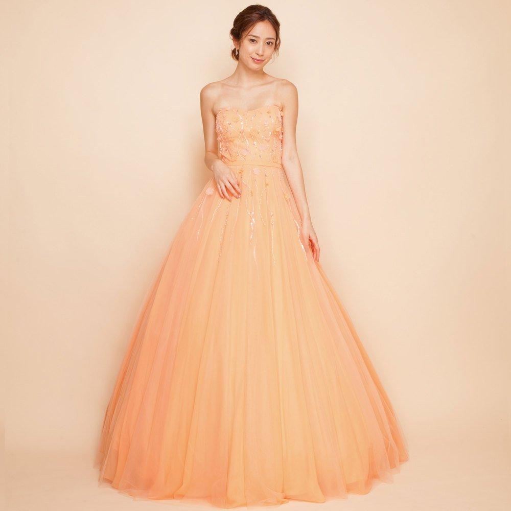 ピンクチュールを重ねたオレンジボリュームロングドレス